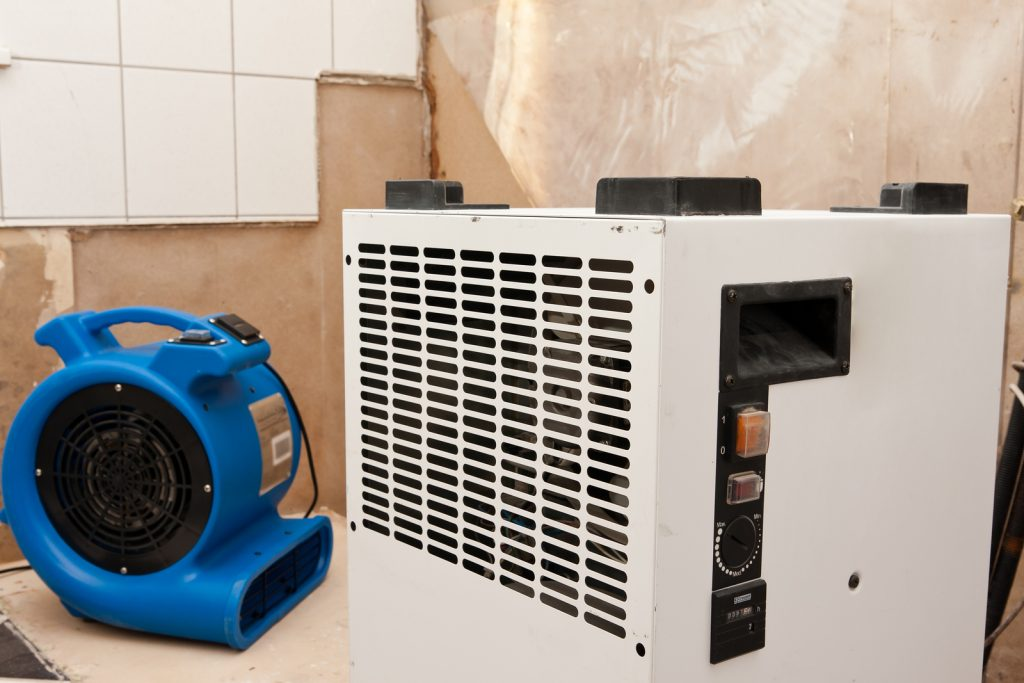 Repairing water damage with fire restoration equipment.