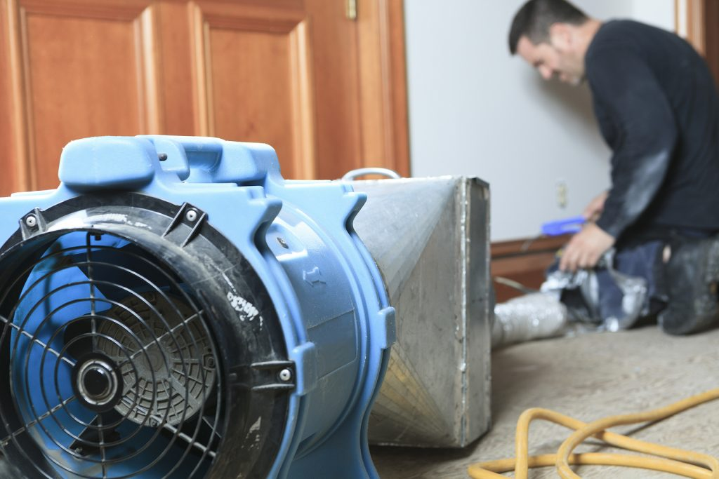 Cleaning out a ventilation system with commercial HVAC equipment financing.